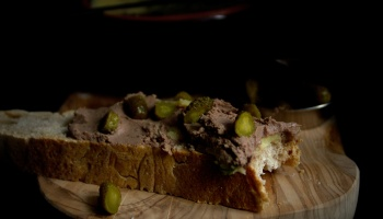 Chicken liver pâté on homemade sourdough bread with bite taken out