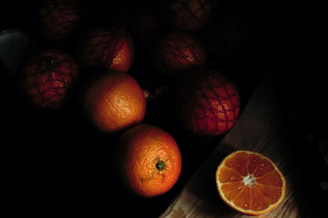 Clementines on a chopping board dark food photography