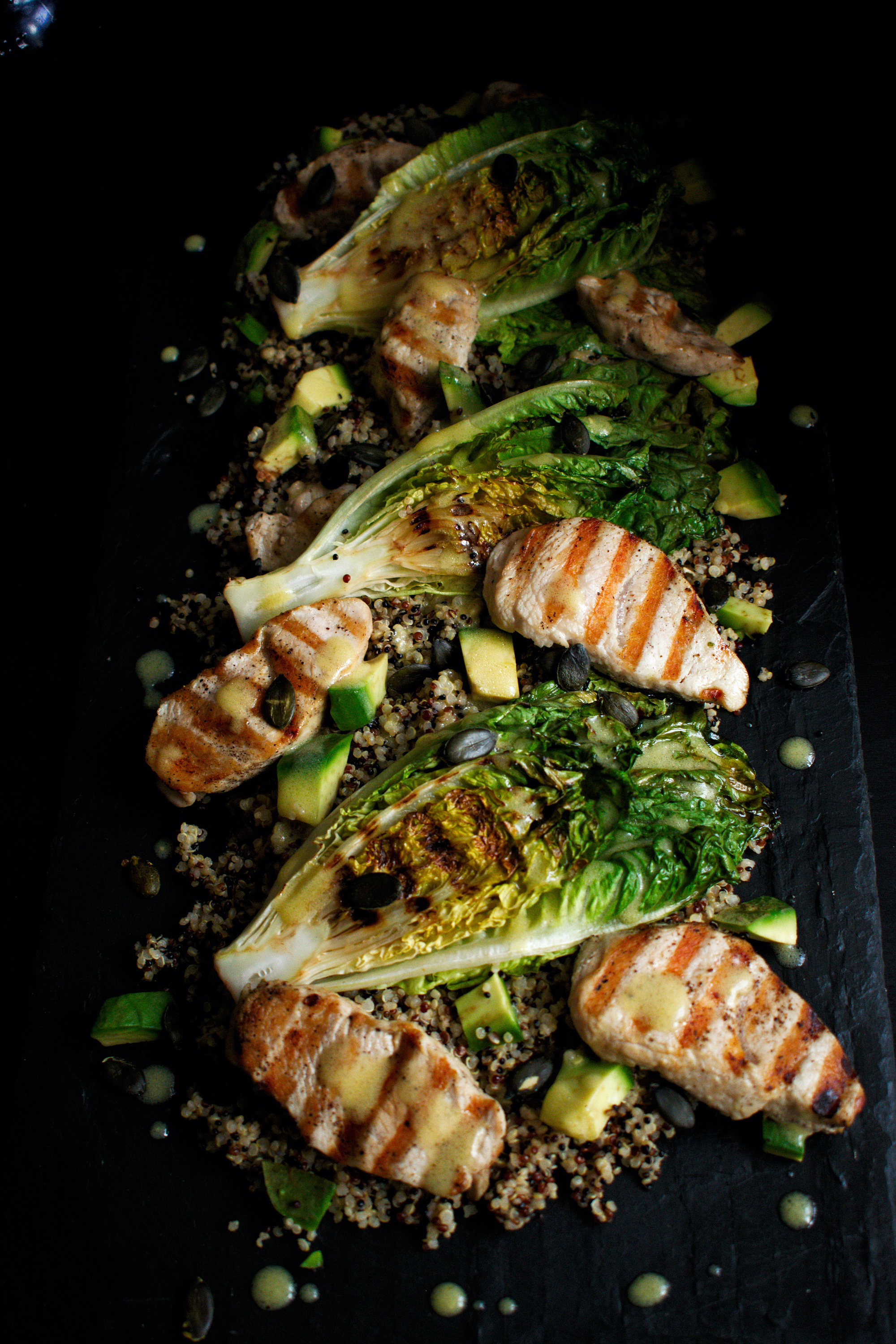 Full image of turkey, quinoa and charred lettuce salad with a lemon mustard dressing