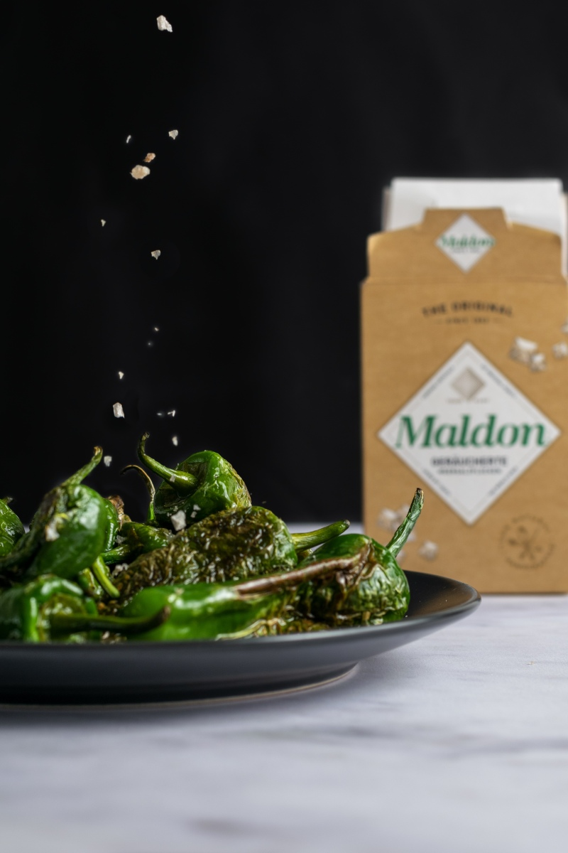Padron peppers being salted